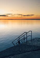 Beautiful Morning Orange Sunrise Scenery At Salthill Beach In Galway City, Ireland