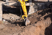 The Modern Excavator JCB Performs Excavation Work On The Construction Site