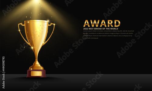 Foto Golden metallic trophy cup first place winner award
