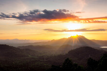 Beautiful Landscape Sunset Over Peak Mountain With Warm Light Mae Moh Lampang, Thailand.