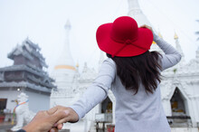 A Young Tourist Wearing A Red Hat Visit Wat Phra That Doi Kong Mu On A Foggy Day, Mae Hong Son Province, Thailand.