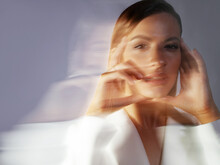 Fashion Portrait With The Effect Of Blurring In Motion At A Long Shutter Speed,