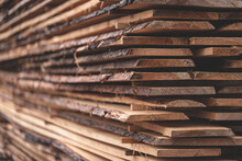 Detail Of Wooden Planks. Wooden Pallets. Wood. Lumber. A Stack Of New Wooden Planks In The Lumber Industry