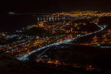Panoramic Night View Of Ushuaia City, Tierra Del Fuego, Argentina. Lights On The Pu-left Corner Are From The Road To The Airport.