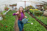 thumb up. daily chores. flower care. horticulture. gardening activity for kid. happy teen girl florist