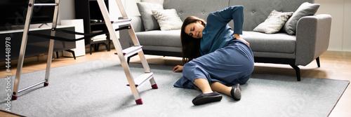 Fotografia, Obraz Clumsy Women Falling Ladder Incident. Injured Person