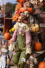 Cute Three Scarecrows And Pumpkins.
