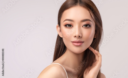 Beautiful Asian woman with  straight hair. Beauty Chinese  girl  clean and white skin.