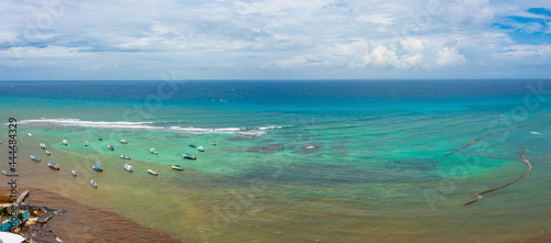 Billede på lærred Aerial view of many sailing boats anchoring next to reef near the Playa Del Carmen town