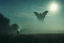 A Horror Concept. Of A Man Looking At A Mysterious Monster Mothman Figure, Flying In The Sky. Silhouetted Against The Moon At Night. With A Grunge, Textured Edit.