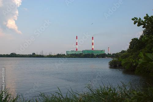 Fotografie, Obraz Power plant on the lake shore