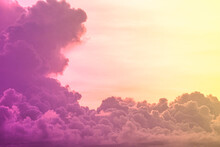 Beauty Abstract Sweet Pastel Soft Purple With Fluffy Clouds On Sky. Multi Color Rainbow Image. Fantasy Growing Light