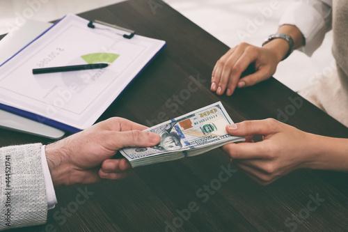 Cashier giving money to businessman at desk in bank, closeup Fotobehang