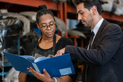 Tablou Canvas Man manager talking recommend and review work from women employees lineage African American in factory auto parts
