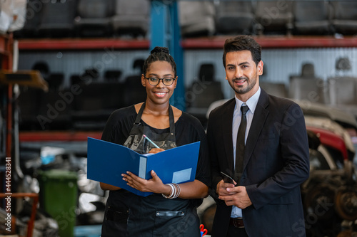 Man managers and women employees lineage African American in factory auto parts Fototapet