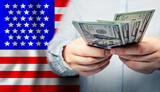 Fototapeta Kawa jest smaczna - American dollars in hands. Coronavirus economic impact stimulus payments or IRS tax refund