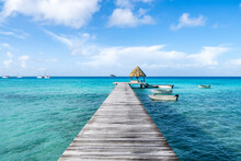 Wooden Pier On A Tropical Island In The South Seas