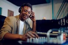 Happy Male Dj In Headphones, Recording Studio