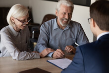 Happy Mature Family Couple Of Clients Consulting Legal Expert, Lawyer, Solicitor About Legal Document Signing, Asking Advice, Question, Talking, Celebrating Deal, House Or Medical Insurance Buying