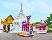 The Purple Singha Lions In Front Of Wat Phra That Hariphunchai Temple, Lamphun, Thailand