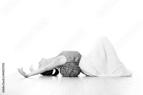 Fotografie, Obraz Restorative yoga with a bolster