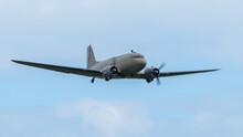A Vintage Dakota Aircraft In Flight With Blue Sky