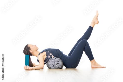 Fototapeta Restorative yoga with a bolster