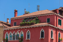 Typical Venetian Building. Red Walls With White Gothic Windows