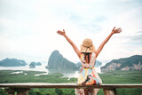 Freedom traveler woman relaxing with raised arms on the top of mountain at Thailand, Enjoy travel concept.