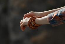 Woman's Hands In Orange Beads