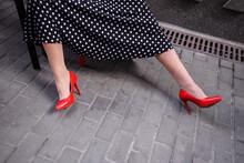 Women Feet In Red Shoes A Polka Dot Dress
