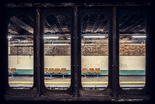 View From The Old Brown Train Window To The Orange Chairs Of The Station