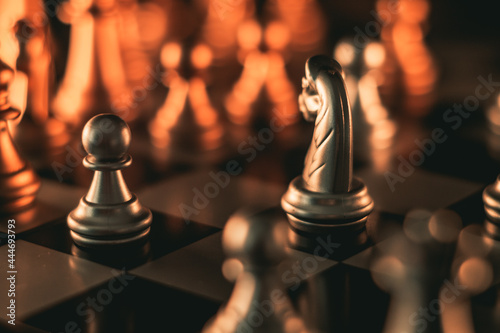 Fotografiet Chess pieces on a chessboard