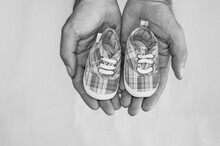 Baby Shoes In Hand  Background