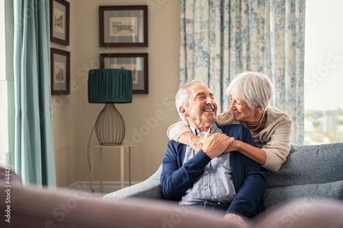 Fotografie, Obraz Senior couple hugging and having fun at home