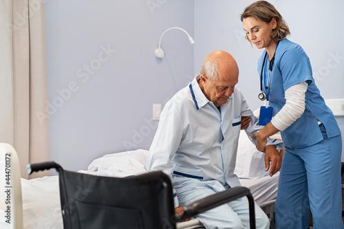 Obraz na plátně Nurse helping senior patient at clinic
