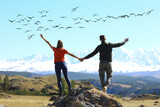 freedom concept, couple in love in a landscape with birds flying