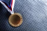Gold medal on velvet cushion. Olympic games