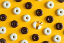 Small Cookie Donuts Of White Chocolate And Dark Chocolate