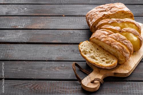Obraz na plátně Fresh bread ciabatta loaf close up. Bakery background