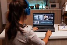 Movie Maker Editing A Film Using Modern Software For Post Production. Content Creator In Home Working On Montage Of Film Using Modern Software For Editing Late At Night.