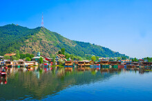 A Variety Of Colorful Boathouses. Beautiful Lake And Mountain Views. View Of Dal Lake In Srinagar, Kashmir State, India. June 2018