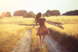 Leinwandbild Motiv girl dress wheat field / happy summer vacation concept, one model in a sunny field