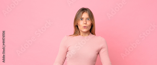 Fotografie, Obraz blonde pretty woman looking goofy and funny with a silly cross-eyed expression,