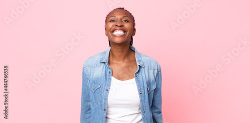 Fotografie, Obraz afro black adult woman looking happy and goofy with a broad, fun, loony smile an