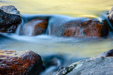 Glacier Creek Flows Serenely Over The Rocks Within Rocky Mountain National Park, Colorado In Late August