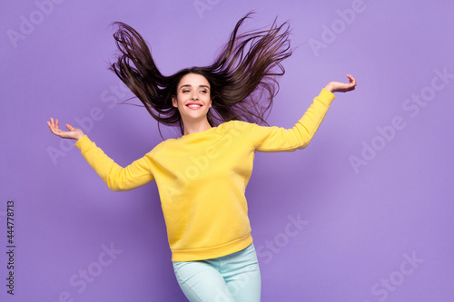 Fototapeta Portrait of attractive dreamy cheerful girl throwing hair pampering isolated ove