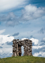 Wooden Gate On The Hill Against The Background Of The Cloudy Blue Sky. Passage Through A Door Made Of Wood. High Quality Photo