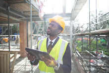Engineer With Digital Tablet At Construction Site