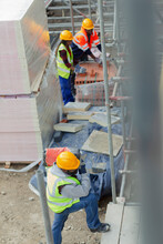 Construction Workers At Construction Site